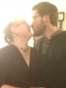 A middle aged couple almost kissing